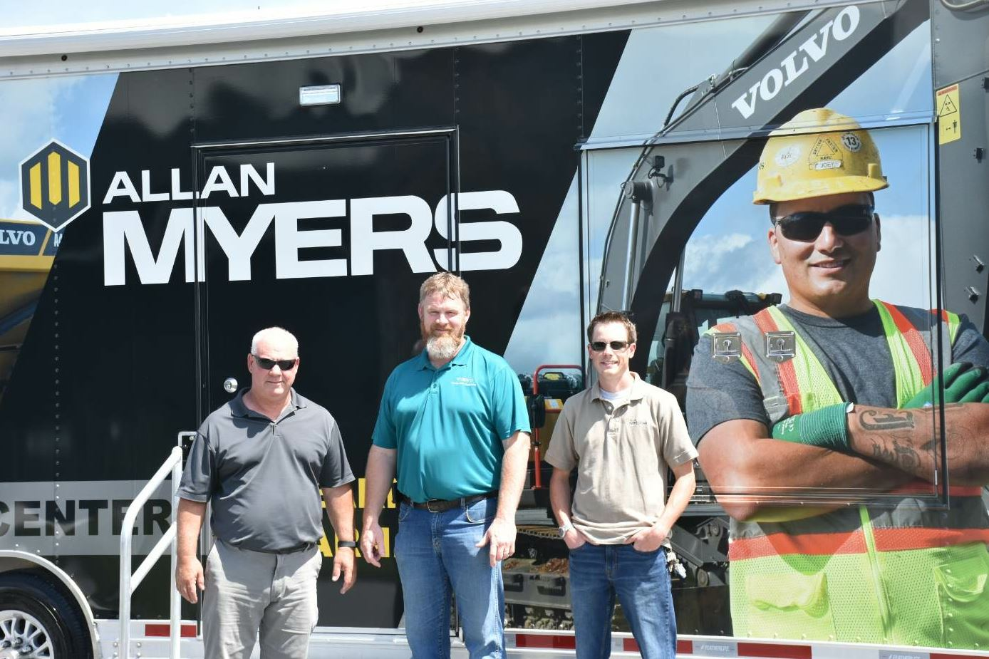 From left: Bill McGowan of Allan Myers, Danny Freeman of Volvo CE, and Andrew Hoffman of Allan Myers display the new Myers Mobile Training Center, which is a fundamental part of the new Stepping Up program at the company.