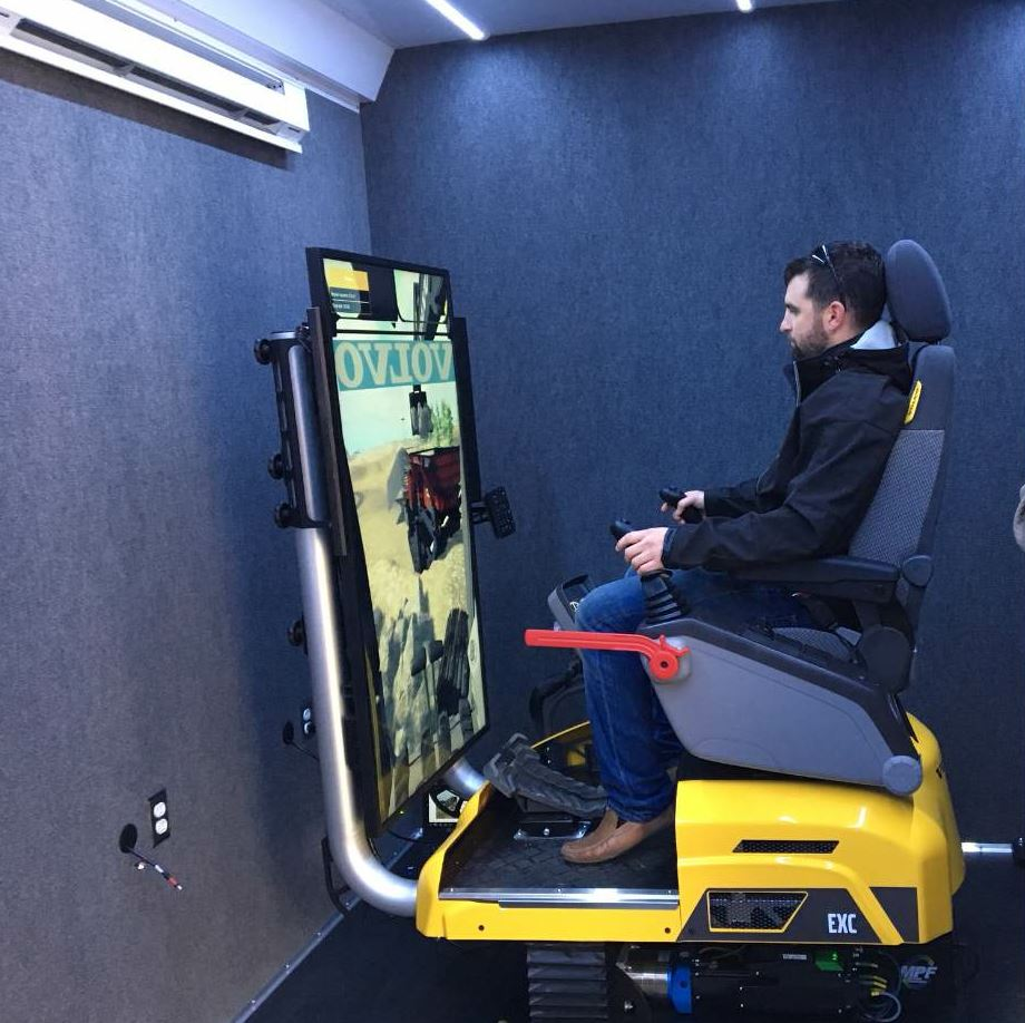 This Volvo CE advanced training simulator is stationed in the Myers Mobile Training Center where employees can try out new skills with lifelike 3-D graphics coupled with an electrically controlled full-motion platform.