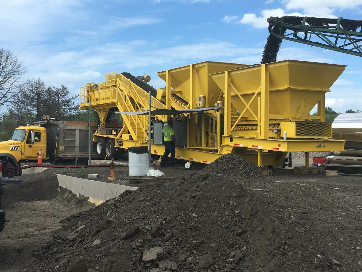 The portable pugmill plant is available in models with capacities ranging from 5 to 1,500 tons per hour. Contractors can bring crushed material to the plant where PennDOT field staff create mix with 100 percent RAP.