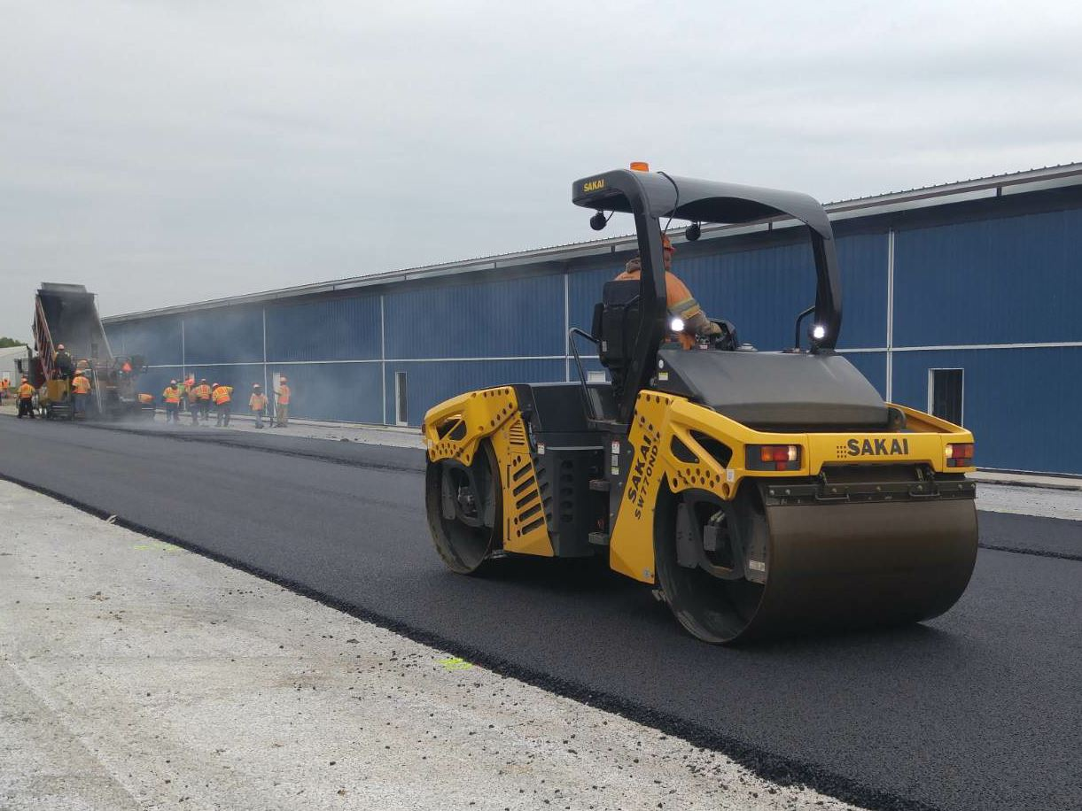 Recently, Chemung constructed executive hangers at Culpeper Airport. In front of the hangers, Chemung placed a foot of No. 1 stone, cement-treated No. 57 stone, and two courses of porous asphalt pavement, IM-19mm and a 12.5mm for the final surface course. The Culpeper Airport porous pavement project won a Green Award from the Virginia Asphalt Association .