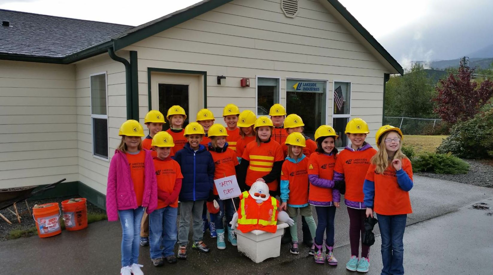 Young students stopped for a photo opp during a field trip to a Lakeside plant.