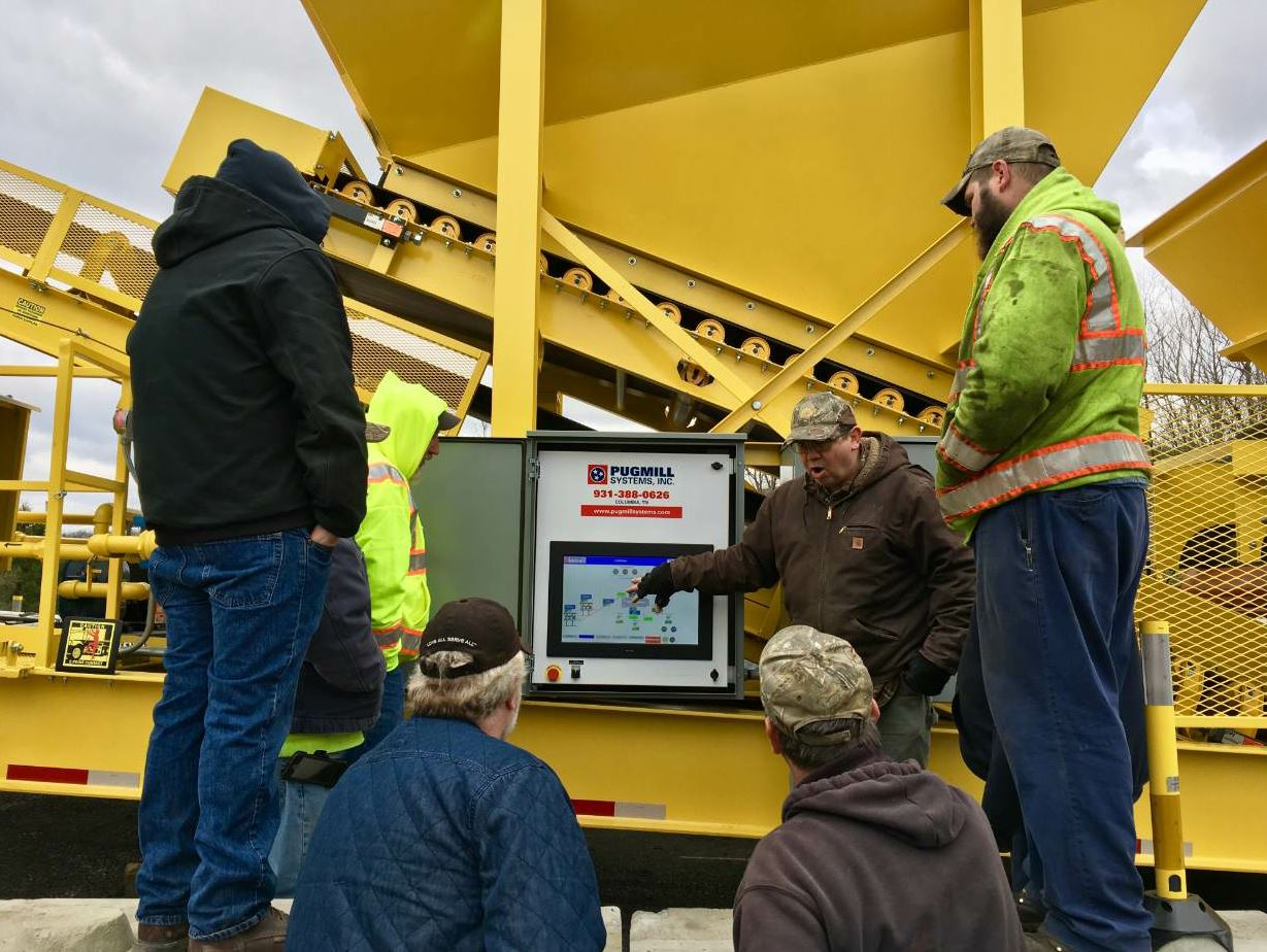 Members of the Pugmill Systems team helped train members of the PennDOT team. Here workers gather for training at one of the portable pugmill plants that PennDOT acquired through its maintenance budget, according to Scott Young. All photos courtesy Pugmill Systems Inc., Columbia, Tennessee.