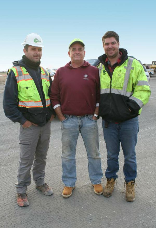 Some of the key players in the JFK taxiway milling project: (from left) Paul Ceglia, Grace's party chief; Jim Cleary, technical support specialist, Cleary Machinery; and J.J. Haugland, Grace's vice president of project development and operations.