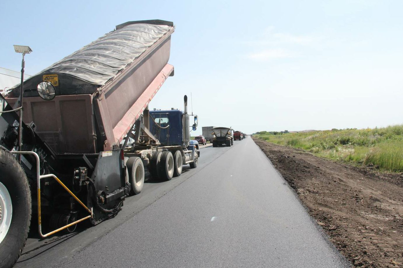 Both lanes of I-88 were overlayed. Both inside and outside shoulders were reconstructed.