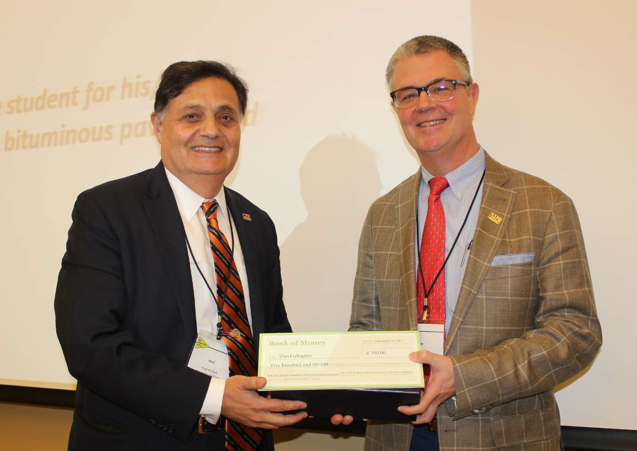 Imad Al-Qadi, on the left, presents the the Imad Al-Qadi Leadership in Bituminous Engineering Award to the 2017 NAPA Chairman Dan Gallagher, on the right, during the 58th Bituminous Paving Conference and first Bituminous Achievement Awards December 2017.