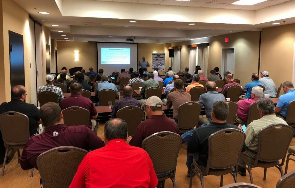 "MAPA's first annual fall meeting was a huge success, Arnemann said. ""The combination of work and play yielded a large turnout,"" he said. Danny Gierhart with the Asphalt Institute is pictured here discussing the PaveXpress module."