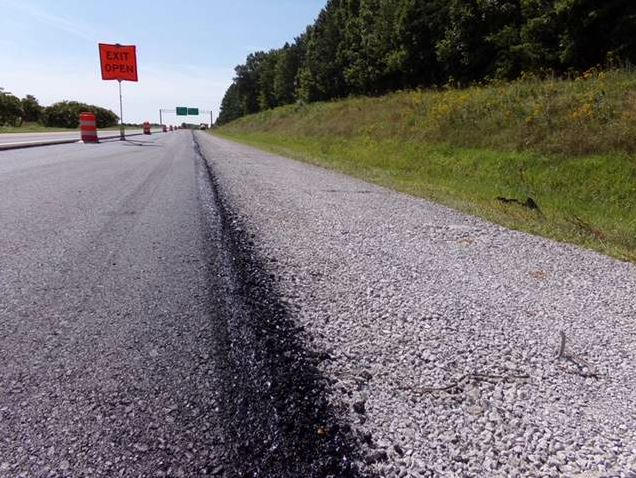 The majority of the project was rubbilized to a depth of 12 inches in the main travel lanes and 9 inches on the shoulder, covered with a 4-inch base lift, 2 inches of IM-19.0D and then 2 inches of SM-12.5D, for a total of 8 inches of asphalt paved in three lifts.