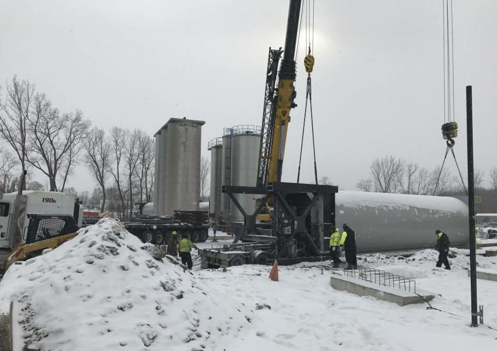 With footings in place and cured, the crew could erect the silos, even in the snow. Photo courtesy Ajax Materials