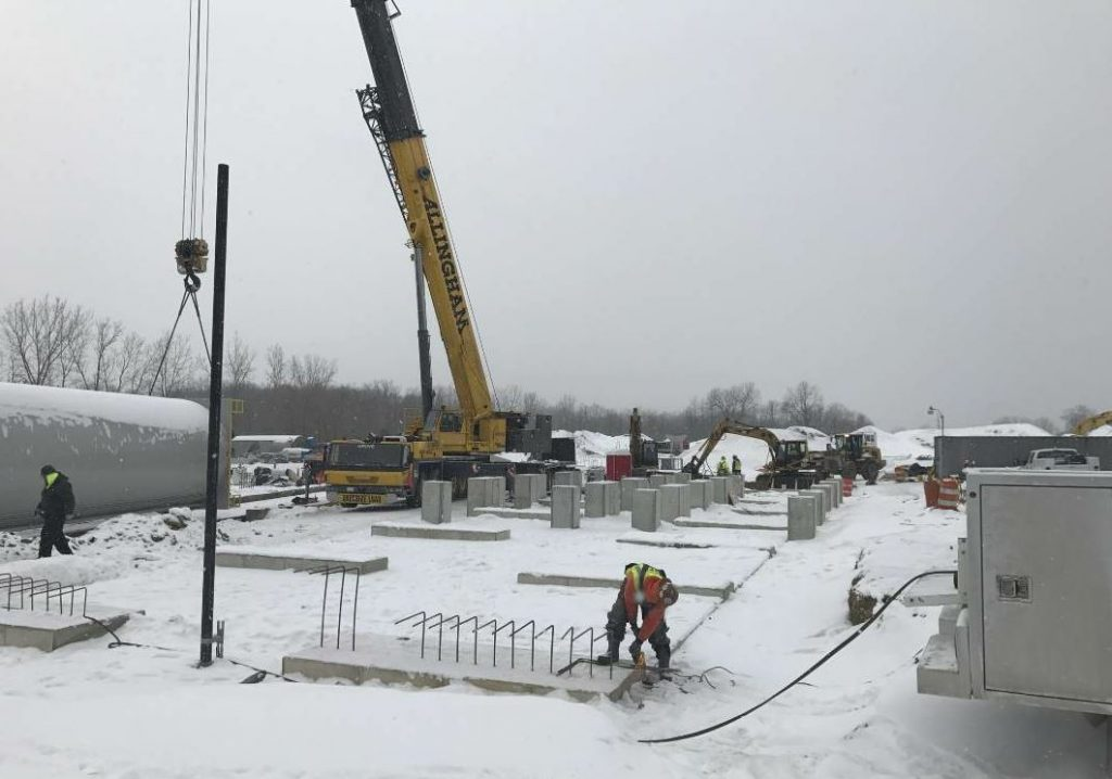 The team sometimes had to heat the ground before pouring concrete to create the forms and footings for plant components. Here the crew gets the silo structure ready. Photos courtesy Ajax Materials