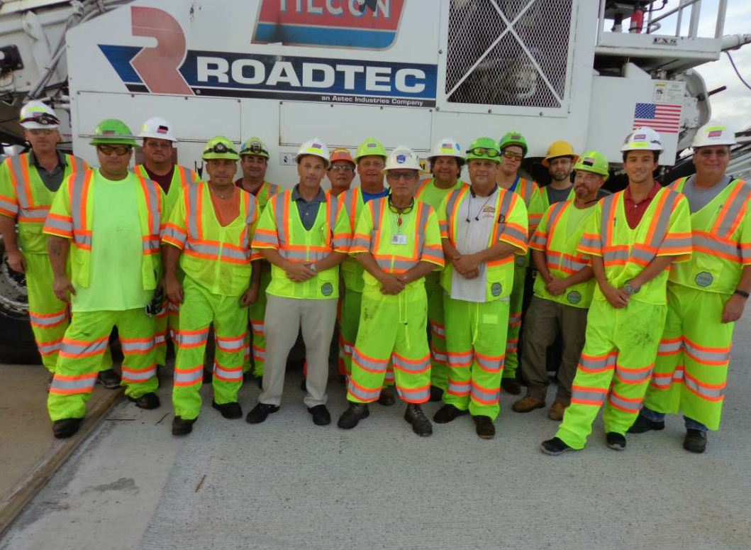 In the center, Sal Rizzo, served as foreman on the job. For the Tappan Zee Bridge, July 31, 2018, 10 trucks brought 22 tons each to the project. That level of production with a quality-minded team spelled success for the project. Photo courtesy John Ball of Top Quality Paving & Training.