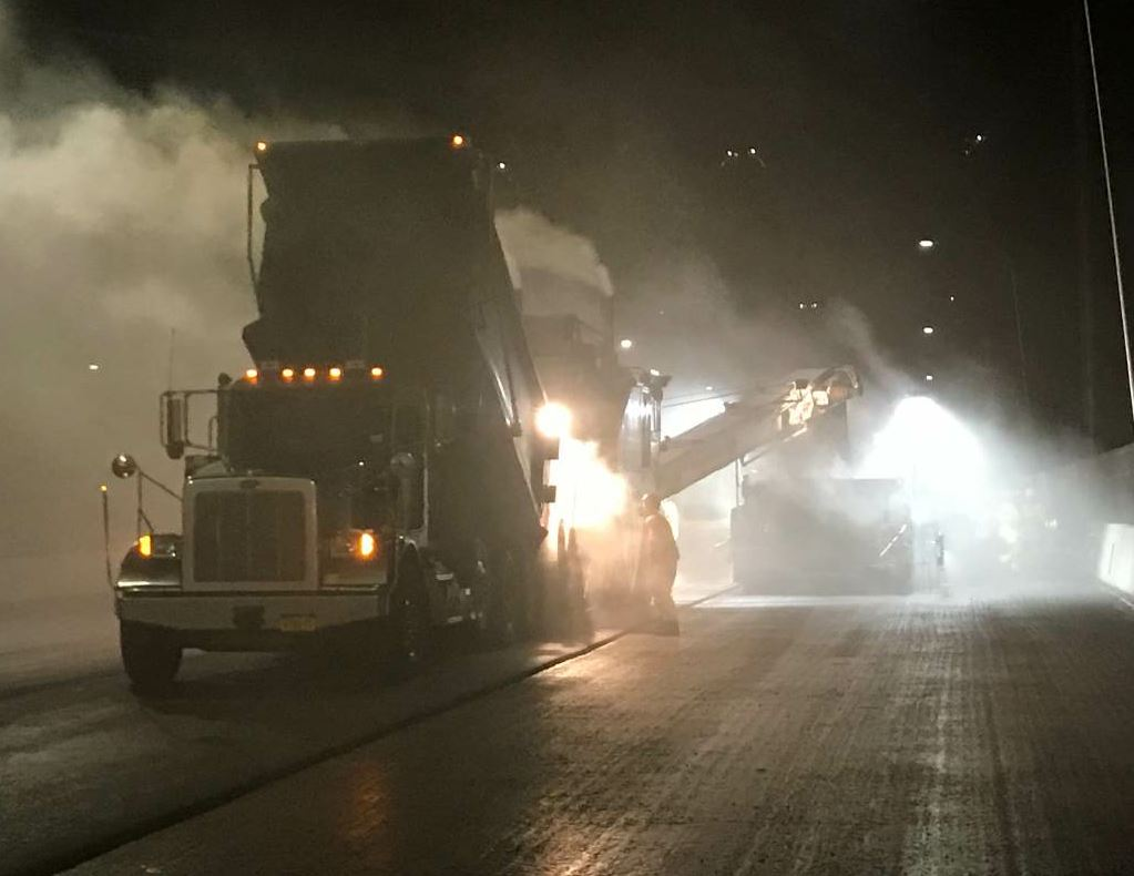 The material arrived at high temperatures, resulting in a steamy atmosphere, even when the crew performed night paving. Both photos courtesy Tilcon New York.