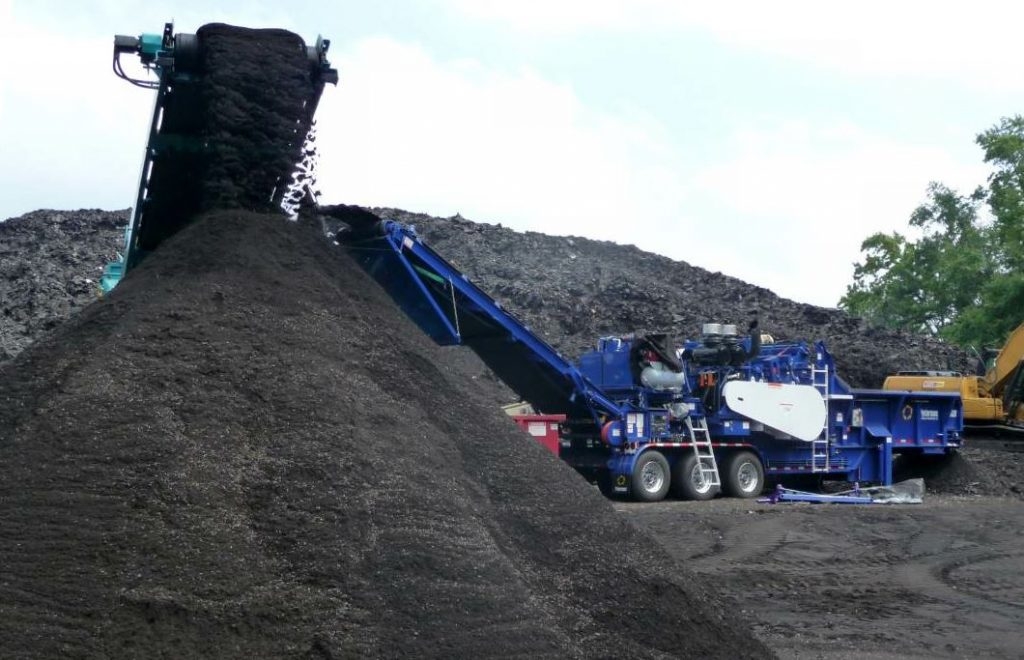 If the RAS is allowed to sit exposed to the elements, it could agglomerate and require additional handling before use in the mix. Photo courtesy Peterson Pacific.