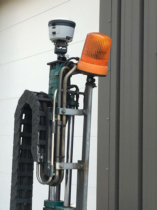 The Trimble R2 GNSS receiver unit is mounted to the coring device.