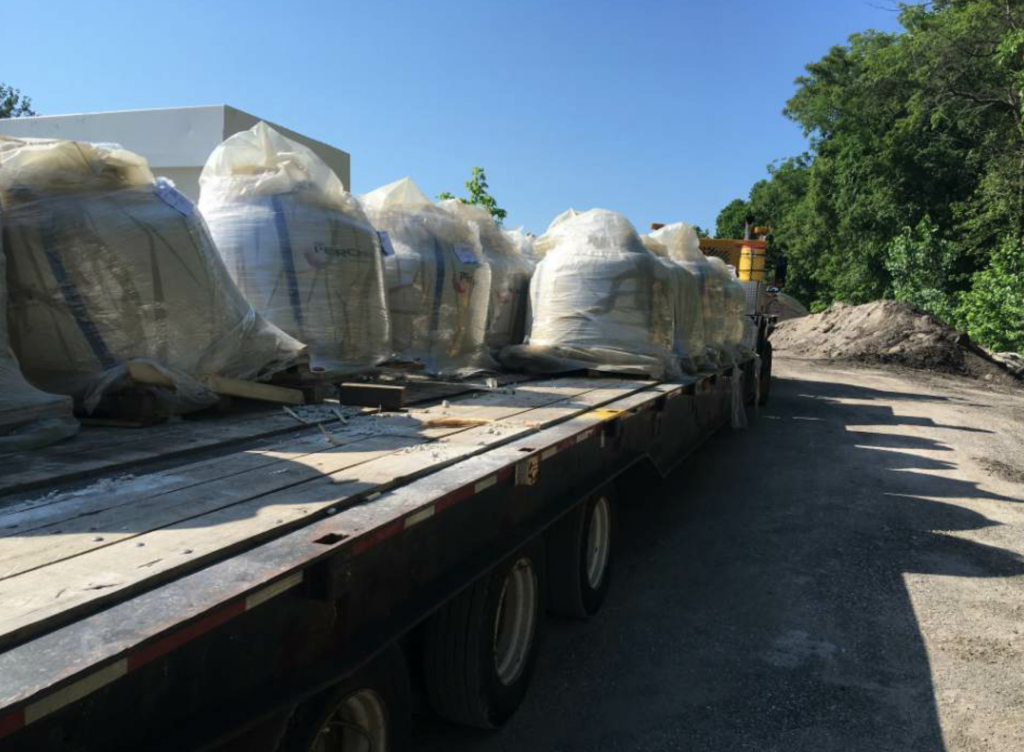 MoDOT ordered and stored the WinterPave material in totes, and then delivered it to the N.B. West plant for mix production.