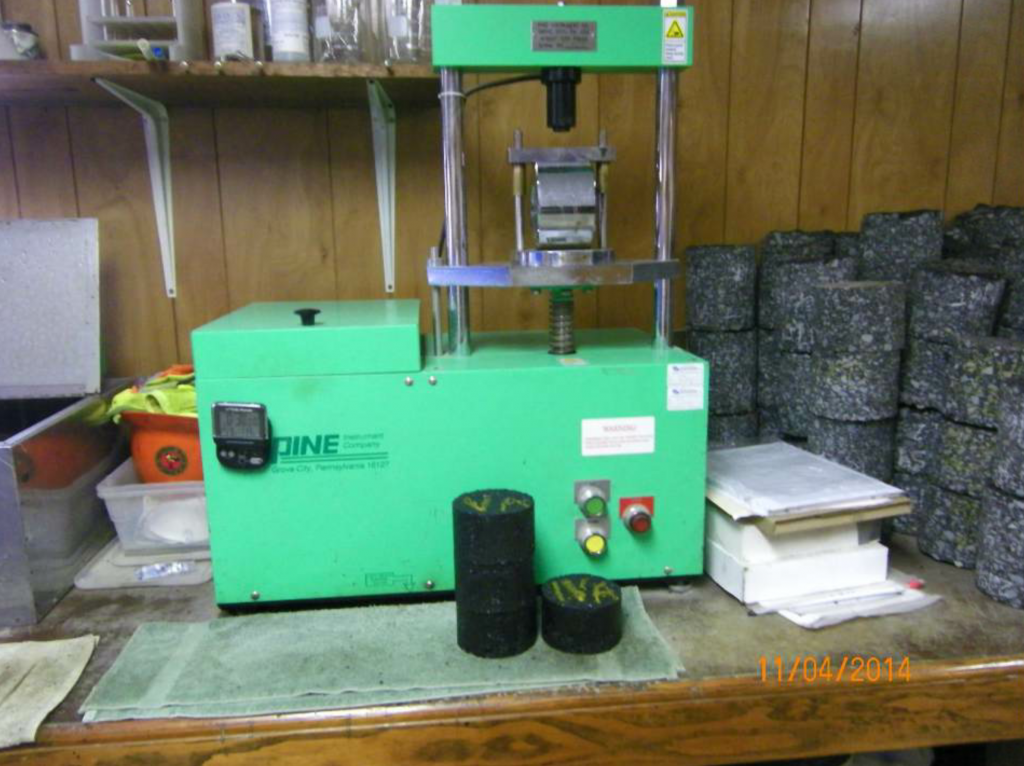 This is the Pine Test Equipment automated 4-inch and 6-inch Marshall Stability & Flow press with recorder. Also pictured is a 4-inch Marshall Stability & Flow compression (breaking) head with a Marshall specimen.