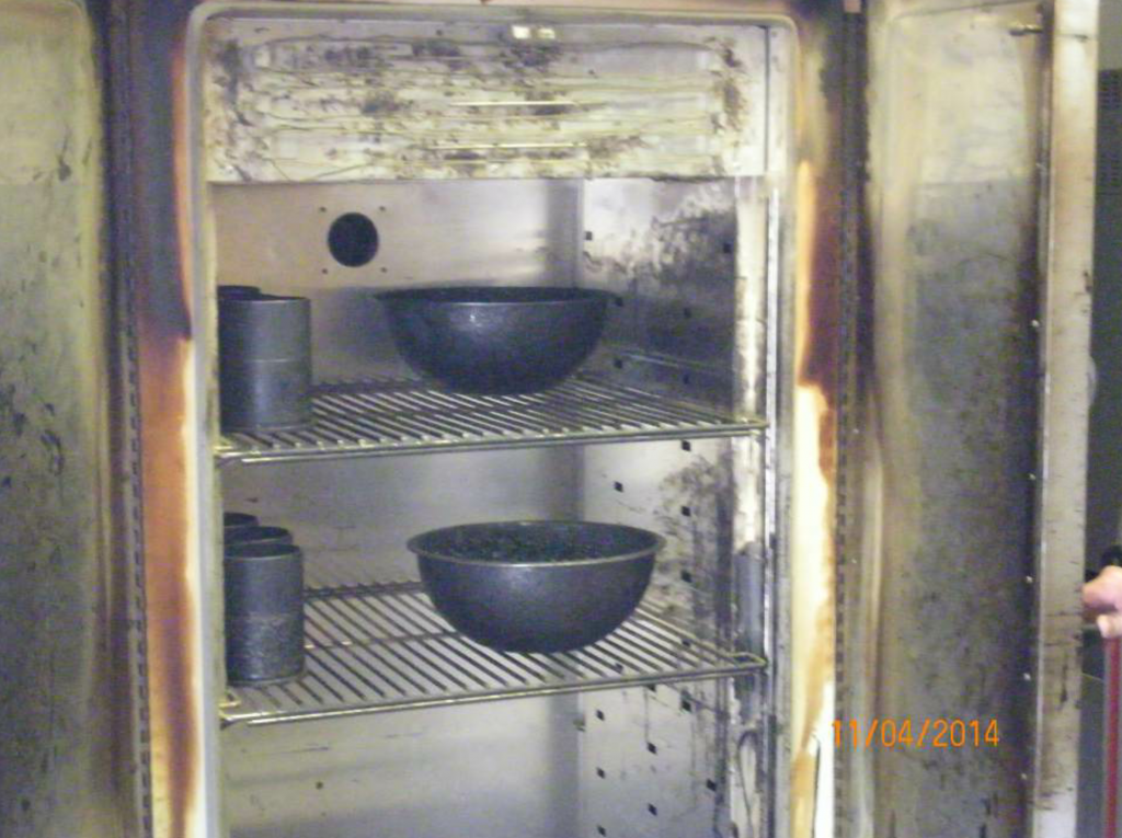 This Barnsted-Thermolyne 18-cubic-foot drying and heating oven has several samples and specimens of mix being heated and aged for testing.