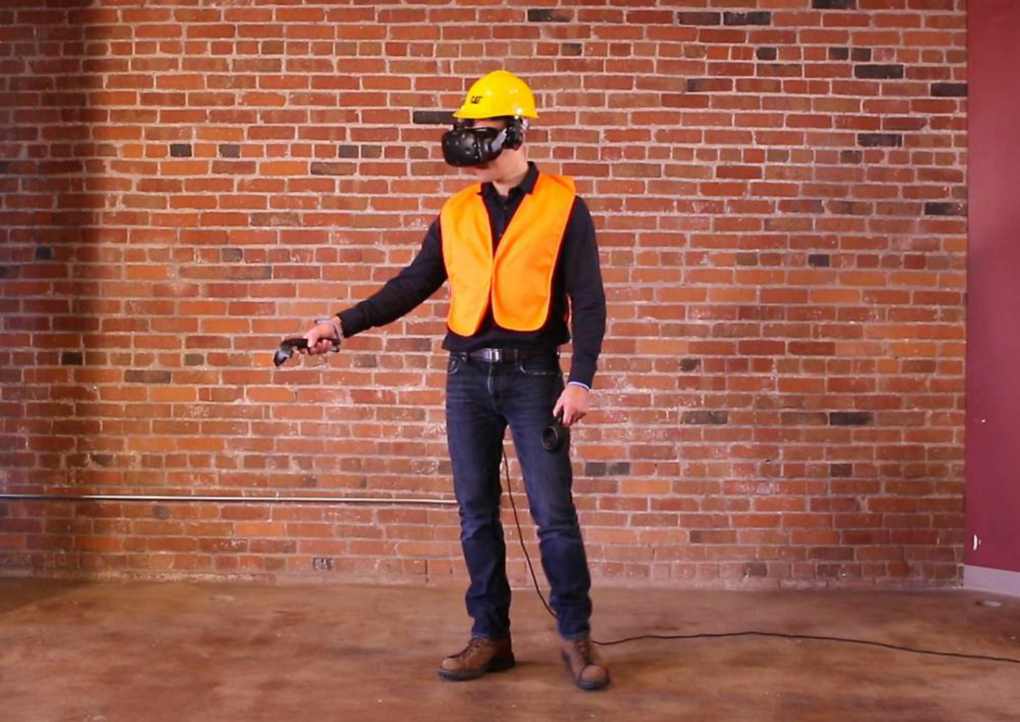 Cat's VR safety training experience requires the user to wear a VR headset, seen here.
