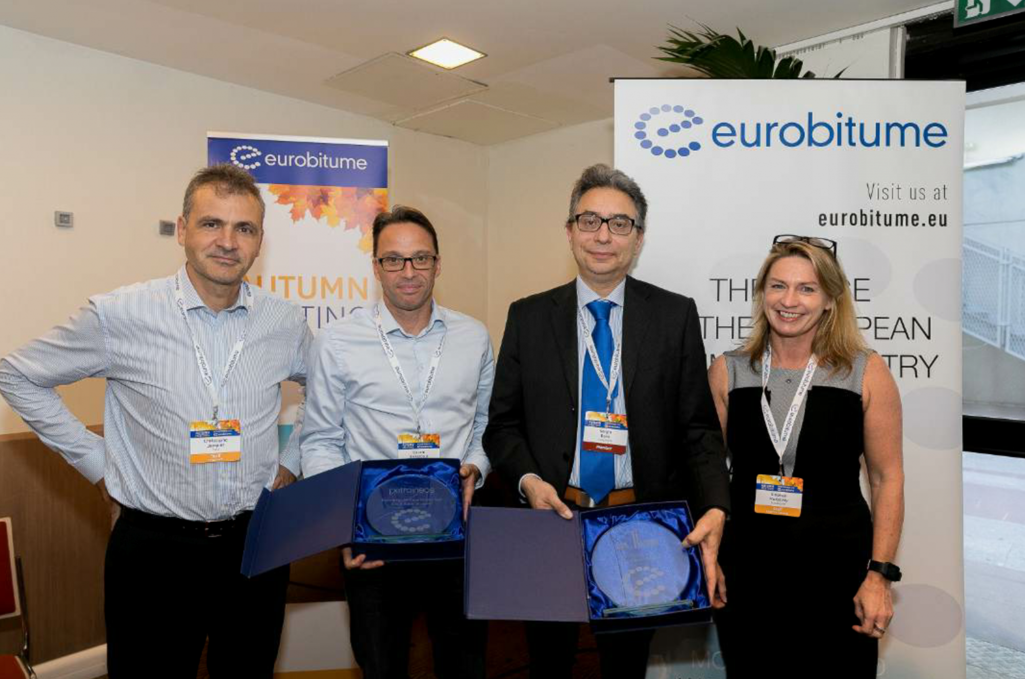 From left to right, Gacem Benazzouz from Petroineos and Sergio Bovo from Alma Petroli are welcomed into the Eurobitume family by Jacquet and McKelvey.